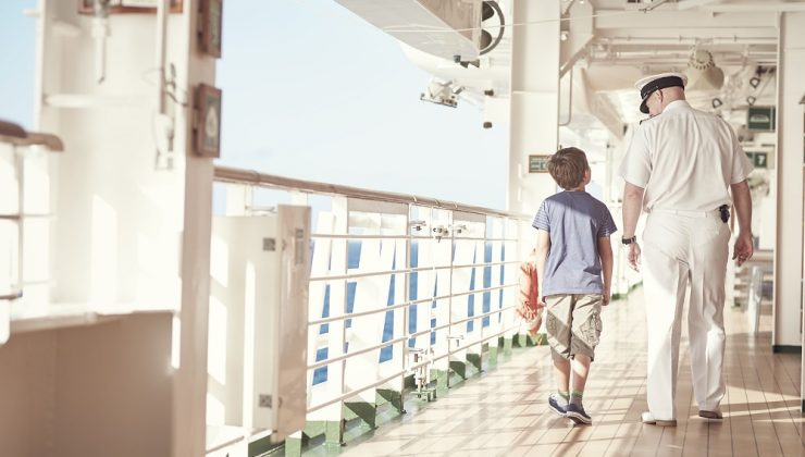 boy and captain on cruise ship